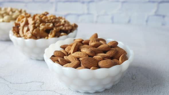 Walnut  Cashew Nut and Almond in a Container on Table