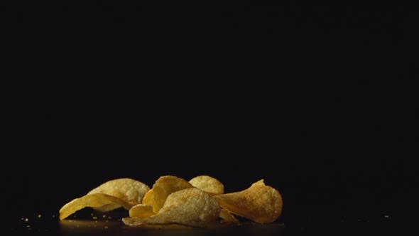 Thumbnail for Potato Chips Fall On A Table