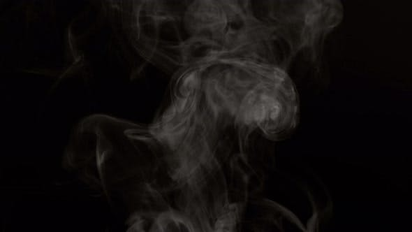 Steam on black background in slow motion, shot with Phantom Flex 4K at 1000 frames per second
