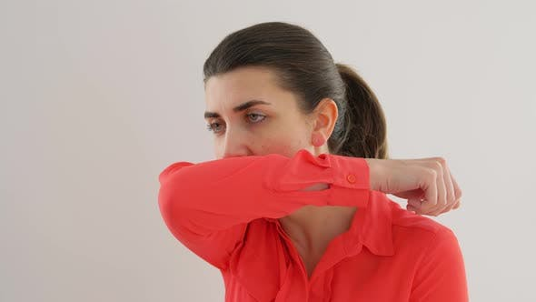 Thumbnail for Woman Coughing Covering Mouth with Elbow