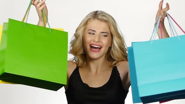 Thumbnail for Beautiful Girl with Colorful Packages. Shopping. White. Slow Motion