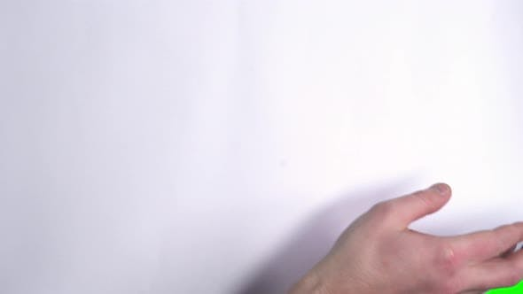 Thumbnail for Male Hand Flips a White Sheet of Paper on a Green Screen.