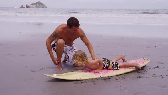 Thumbnail for Father teaching son how to surf. Shot on RED EPIC for high quality 4K, UHD, Ultra HD resolution.