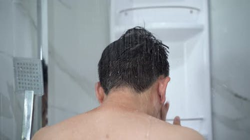 Man Taking Shower in Modern Bathroom
