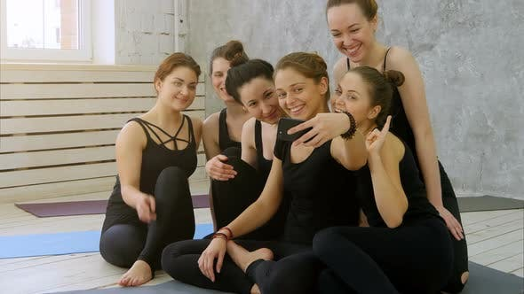 Thumbnail for Group of Young Women Taking Selfie Using Cell Phone at Yoga Class