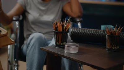 Close Up of Art Tools and Pencils on Table in Artwork Space