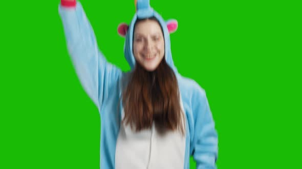 Thumbnail for Portrait of a cute young brunette girl in a beautiful unicorn costume
