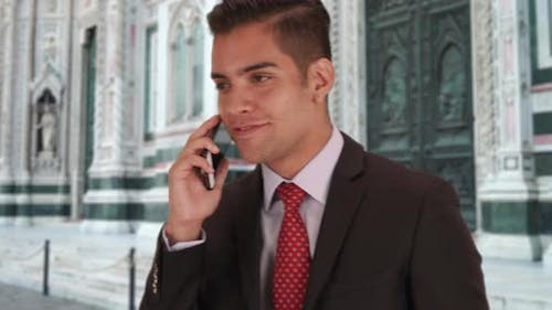 Latino businessman talking with client on cellphone Duomo di Firenze in Florence