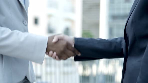 Thumbnail for Slow Motion Shot of People Shaking Hands Outdoor