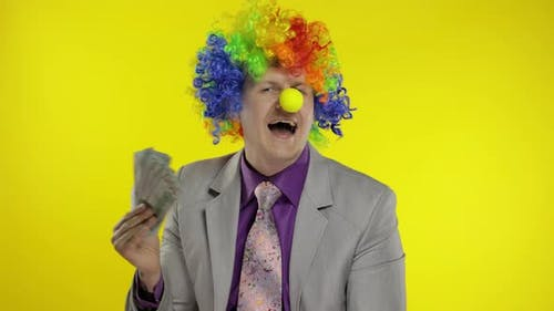 Clown Businessman Entrepreneur Boss in Wig with Money Banknotes at Work