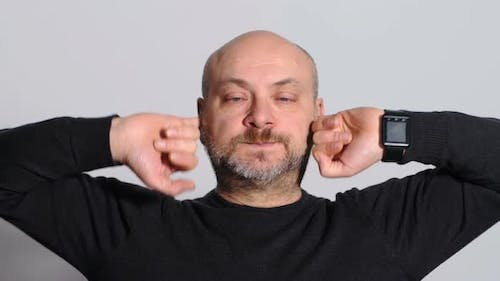 Funny and Humorous Man Who Fills His Ears with Pinkies
