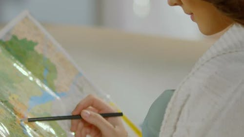 Young Woman Holding Pencil Over Map, Planning Travel Itinerary, Holiday-making