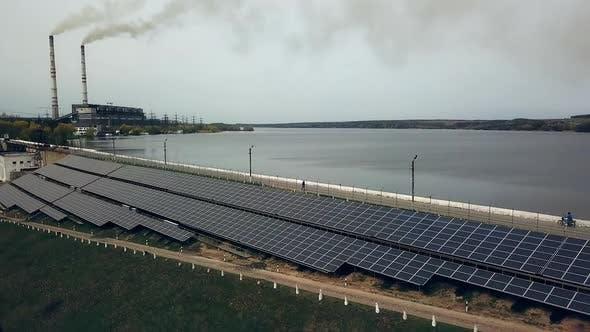 Solar energy farm. Solar panels near the river. Alternative source of electricity.