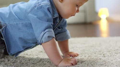 Caucasian Baby Crawling on All Fours