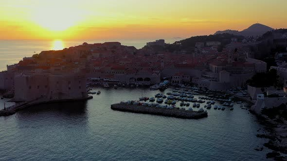 Thumbnail for Dubrovnik Old Town, city walls and harbor at sunset