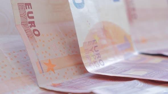 Thumbnail for Europäische Währungsunion Papier-Banknoten angeordnet langsam neigen 4K 2160p UltraHD Filmmaterial - Euro 10 Papier