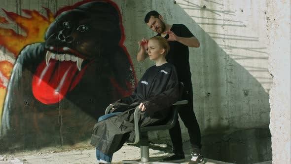 Thumbnail for Hairdresser Making Haitcut for a Blond Girl. Urban