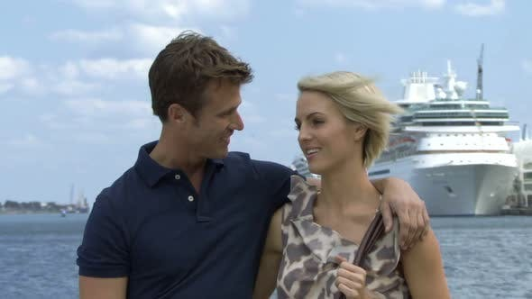 Thumbnail for Romantic couple near a harbour with cruise ship in background