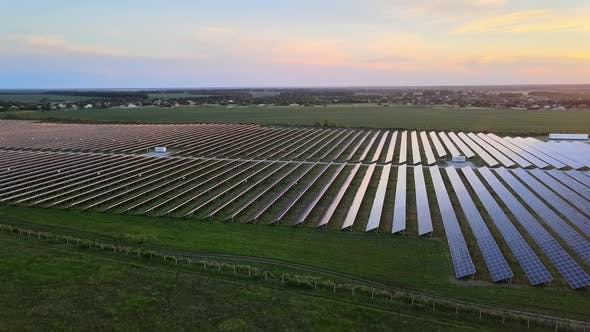 Thumbnail for Aerial View of Large Solar Panels at a Solar Farm at Bright Summer Sunset. Solar Cell Power Plants