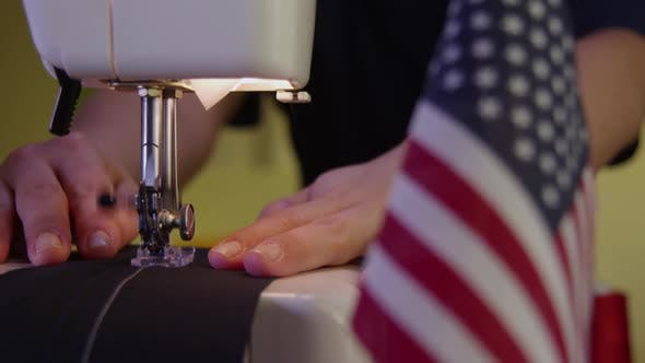 Thumbnail for Tailor Sewing Next To An American Flag 30