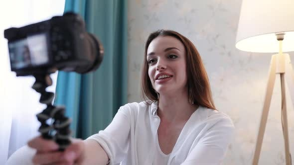 Woman Filming Video Blog On Camera At Home