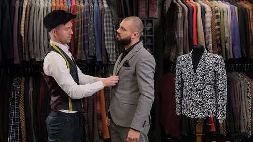 suit design with tailor in atelier