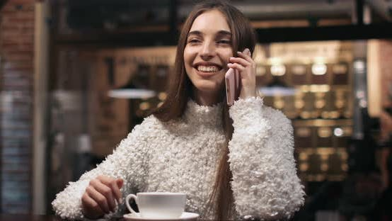 Cover Image for Girl Talking on Phone in Cafe