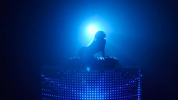 Blond Girl Dj Sexy Dancing in Blue Silhouette
