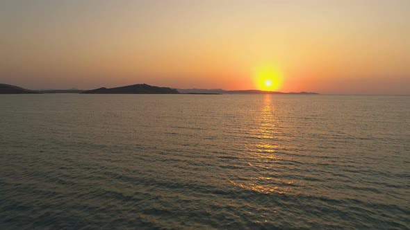 Thumbnail for Orange and Golden Sunset Over Sea Horizon in Greek Island