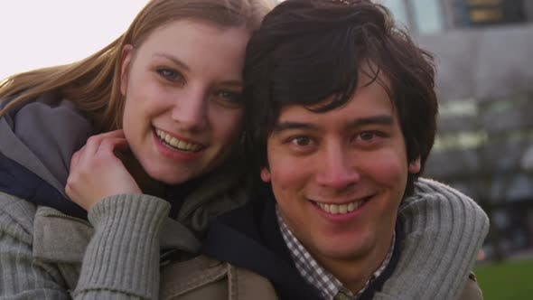 Thumbnail for Portrait of young couple at city park, slow motion