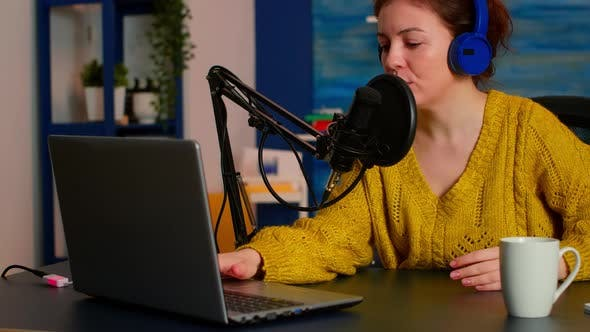 Woman Podcaster Recording Audio Podcast on Laptop Computer