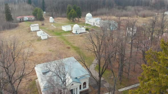 Thumbnail for Observatory and Other Research Buildings on the Field Surrounded By Bare Trees