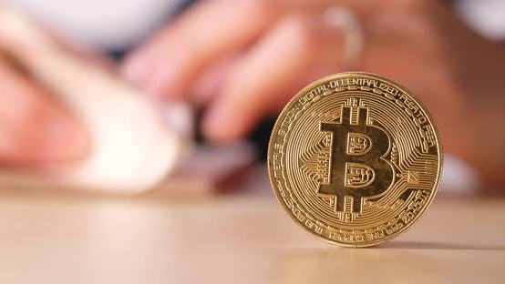 Thumbnail for Bitcoin with counting money banknote at the back