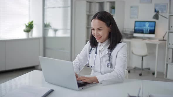 Thumbnail for Doctor Chatting On LaptopDuring Break