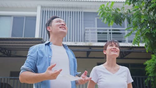 Asian young couple take deep breathing after removing protective face mask after quarantine.