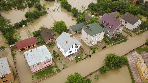 Aerial view of flooded houses with dirty water of Dnister river in Halych town, western Ukraine
