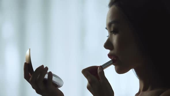 Thumbnail for Charming Girl Carefully Putting on Red Lipstick, Slowly Painting Beautiful Lips