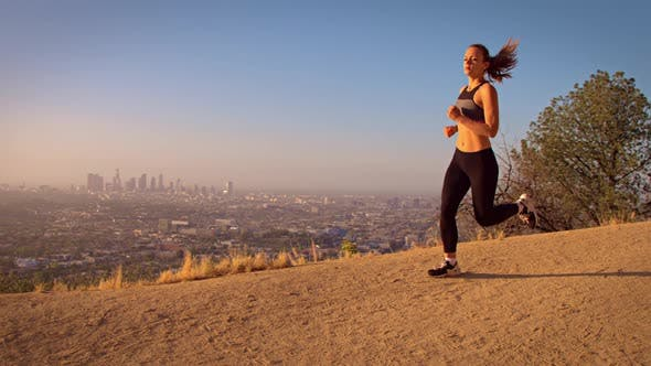 Thumbnail for Fit Woman Jogging Los Angeles Slow-Motion
