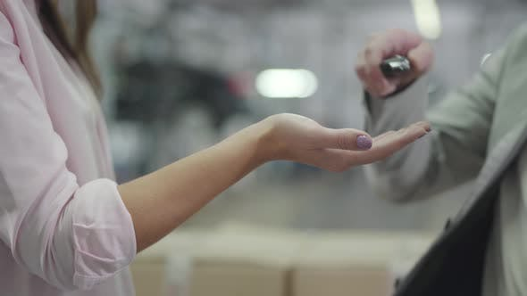 Thumbnail for Close-up of Male Caucasian Hand Giving Car Keys To Unrecognizable Female Customer