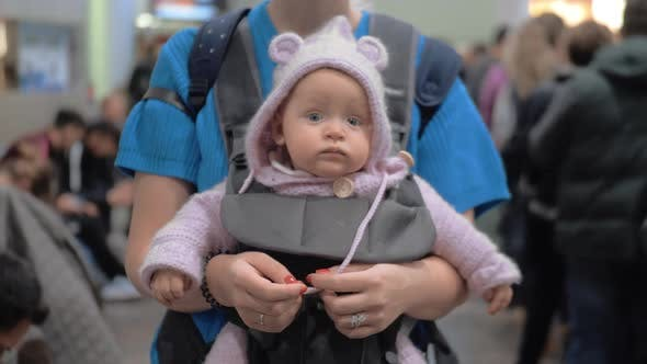 Cute Baby in Mothers Kangaroo Carrier
