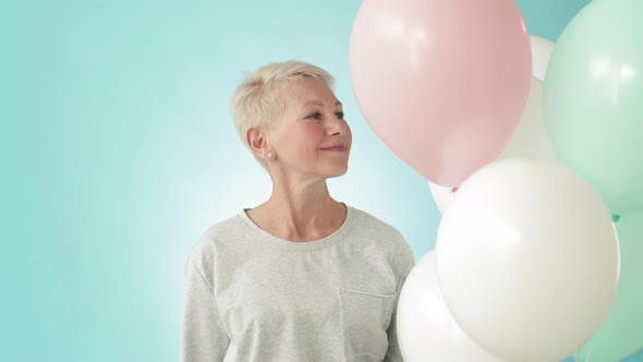 Thumbnail for Portrait of Happy Aged Woman with Balloons