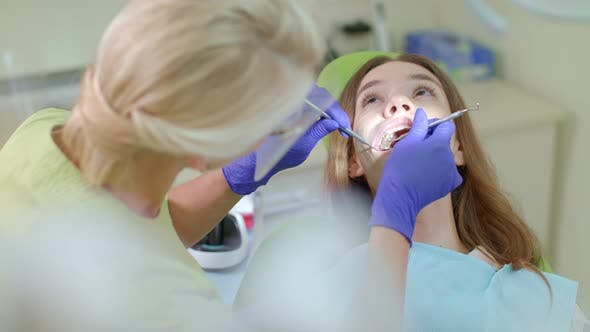 Thumbnail for Dentist Examining Patient Teeth in Medical Gloves. Dental Curing of Patient