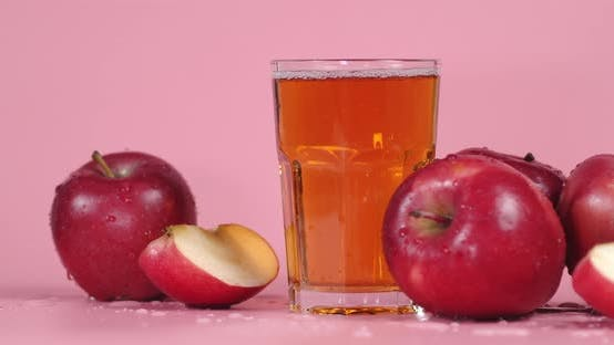 Glass of Fresh Apple Juice Rotating.