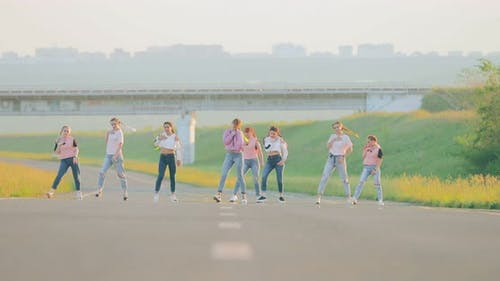 Girls Dancing Hiphop on the Road in Summer