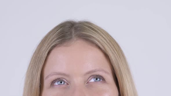 Thumbnail for Eyes of Young Happy Blonde Woman Thinking