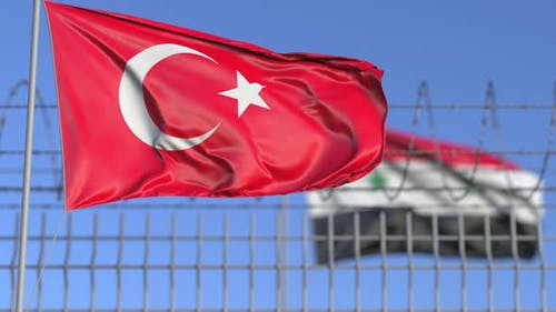 Waving Flags of Turkey and Syria Separated By Barbed Wire