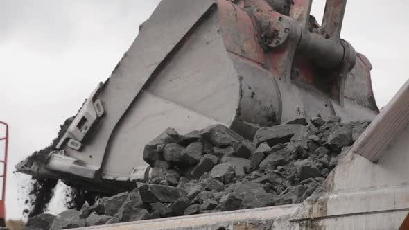 Thumbnail for An Excavator Bucket Digs Coal