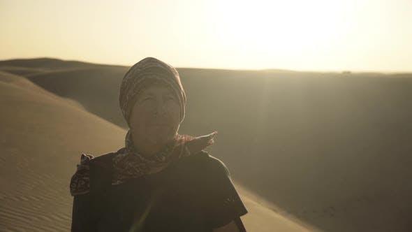 Thumbnail for Man In Bandana Walking Through Desert
