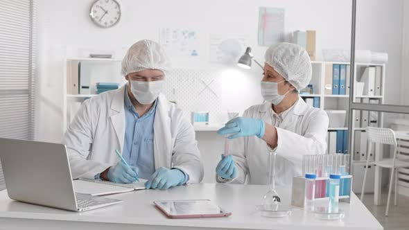 Medical Workers Making Tests in Laboratory