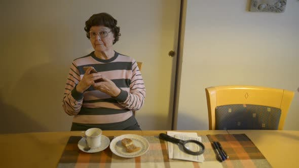 Thumbnail for Happy Senior Woman Talking on the Phone at Home